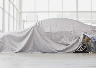 Apple car auto onder laken